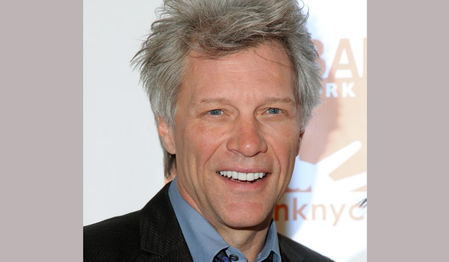 FILE - In this April 20, 2016 file photo, Jon Bon Jovi attends the Food Bank For New York City Can-Do Awards Dinner in New York. In an interview on Wednesday, Oct. 19, Bon Jovi dispelled rumors that he plans to buy the Tennessee Titans. An earlier news report claimed that Bon Jovi and Peyton Manning were monitoring the Tennessee Titans ownership situation, leading to speculation they were looking to purchase the team. That prompted Titans acting owner Amy Adams Strunk to say the team is not for sale. (Photo by Andy Kropa/Invision/AP, File)