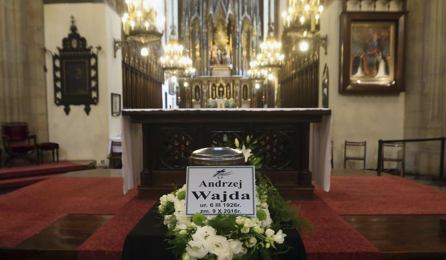 The urn holding the ashes of Poland's filmmaker Andrzej Wajda is placed for a farewell ceremony, in Krakow, Poland, Wednesday, Oct. 19, 2016. Wajda died in hospital on Oct. 9, at the age of 90. He will be laid to rest at Krakow's Salwator Cemetery where his mother is buried. (AP Photo/Czarek Sokolowski)