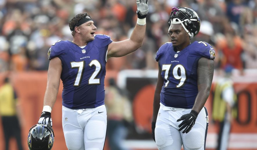 FILE- In this Sept. 18, 2016, file photo, Baltimore Ravens offensive guard Alex Lewis (72) and offensive tackle Ronnie Stanley (79) stand on the field in the first half of an NFL football game against the Cleveland Browns in Cleveland.  Lewis, a fourth-round draft pick, has proven to be both versatile and invaluable as a starter on the Baltimore Ravens' offensive line, a unit decimated by injuries to several key players. (AP Photo/David Richard, File)