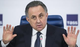 FILE - In this Friday, Dec. 25, 2015 file photo, Russian Sports Minister Vitaly Mutko gestures during a news conference in Moscow, Russia. Russian sports minister Vitaly Mutko, who has come under scrutiny in Russia's doping scandal, has been promoted to a deputy prime minister, on Wednesday Oct. 19, 2016. State news agency Tass says President Vladimir Putin approved a proposal by Prime Minister Dmitry Medvedev to appoint Mutko to a deputy premiership in charge of sport, tourism and youth policies. (AP Photo/Pavel Golovkin, File)