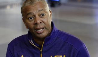 LSU coach Johnny Jones answers a question during the Southeastern Conference men's NCAA college basketball media day, Wednesday, Oct. 19, 2016, in Nashville, Tenn. (AP Photo/Mark Zaleski)