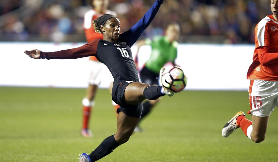 United States' Crystal Dunn (16) reaches for the ball as Switzerland's Caroline Abbe (15) defends during the first half during an international friendly soccer match Wednesday, Oct. 19, 2016, in Sandy, Utah. (AP Photo/Rick Bowmer)