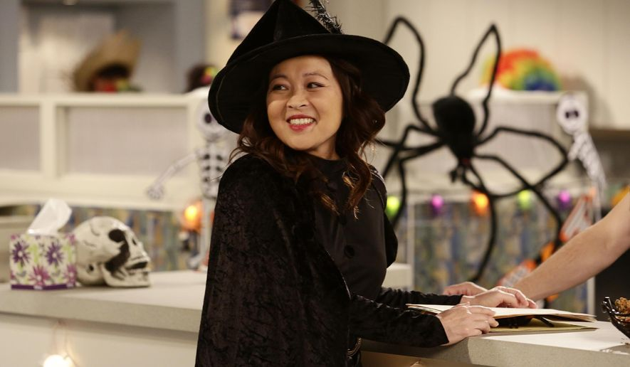 """In this image released by ABC, Suzy Nakamura appears in a scene from the upcoming Halloween episode of """"Dr. Ken,"""" airing Oct. 21, on ABC. (Nicole Wilder/ABC via AP)"""