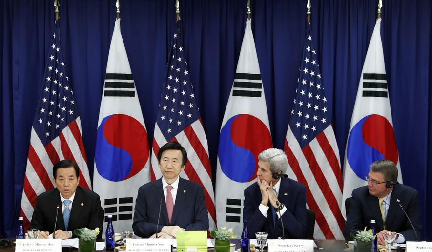 South Korean Defense Minister Han Min-koo speaks at left, as, from second from left, South Korean Foreign Minister Yun Byung-se, Secretary of State John Kerry, and Defense Secretary Ash Carter listen before a meeting at the State Department in Washington, Wednesday, Oct. 19, 2016. (AP Photo/Alex Brandon)