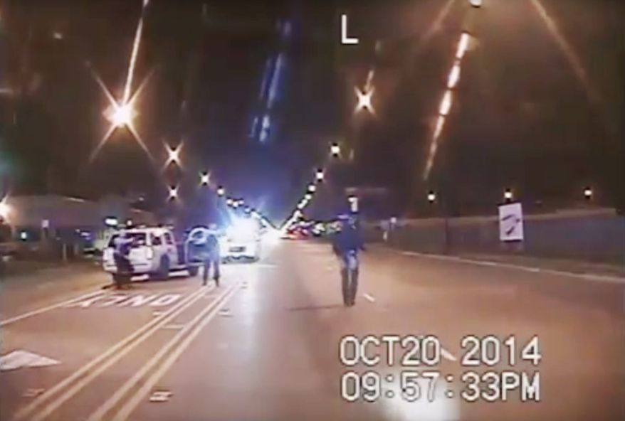 A dash-cam video from the Chicago Police Department shows Laquan McDonald moments before his fatal shooting. Two years later, the OpenOversight website has been launched to help the public identify police officers accused of misconduct. (Associated Press)