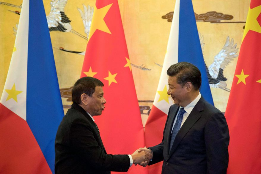 Philippine President Rodrigo Duterte (left) received a warm welcome from Chinese President Xi Jinping on Thursday. Mr. Duterte's visit is part of a charm offensive aimed at seeking trade and support from the Asian giant by setting aside a territorial dispute. (Associated Press)