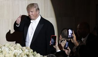 Republican presidential nominee Donald Trump, gestures as he walks to the Dais at the 71st Annual Alfred E. Smith Memorial Foundation Dinner Thursday, Oct. 20, 2016, in New York. (AP Photo/Frank Franklin II)