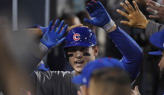 Anthony Rizzo of the Cubs is congratulated after hitting a home run during the fifth inning of Game 4 of the National League Championship Series against the Dodgers on Wednesday in Los Angeles. (Associated Press)