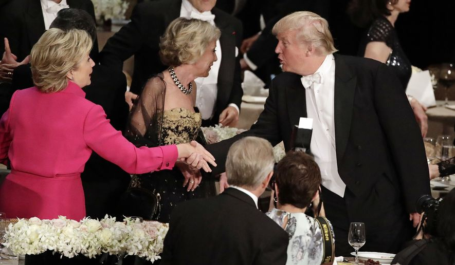 Democratic presidential candidate Hillary Clinton, left, shakes hands with Republican presidential candidate Donald Trump, right, at the 71st Annual Alfred E. Smith Memorial Foundation Dinner Thursday, Oct. 20, 2016, in New York. (AP Photo/Frank Franklin II)