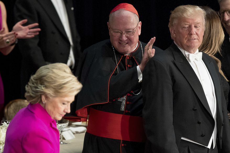 Democratic presidential candidate Hillary Clinton and Republican nominee Donald Trump joined Cardinal Timothy Dolan, Archbishop of New York, at the 71st annual Alfred E. Smith Memorial Foundation Dinner last month in New York. (Associated Press)