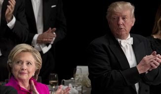 Democratic presidential candidate Hillary Clinton, left, and Republican presidential candidate Donald Trump, right, stand next to each other towards the end of the 71st annual Alfred E. Smith Memorial Foundation Dinner, a charity gala organized by the Archdiocese of New York, Thursday, Oct. 20, 2016, at the Waldorf Astoria hotel in New York. (AP Photo/Andrew Harnik)