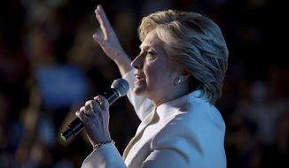 Democratic presidential candidate Hillary Clinton speaks to a debate watch party at the Craig Ranch Regional Amphitheater in North Las Vegas, Nev., Wednesday, Oct. 19, 2016, following the third presidential debate. (AP Photo/Andrew Harnik)