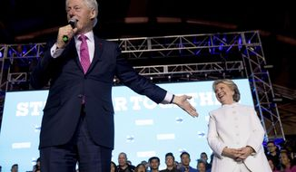 Former President Bill Clinton, left, accompanied by Democratic presidential candidate Hillary Clinton speaks at debate watch party at the Craig Ranch Regional Amphitheater in North Las Vegas, Wednesday, Oct. 19, 2016, following the third presidential debate. (AP Photo/Andrew Harnik)