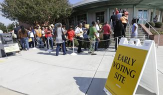 Voters line up Thursday, Oct. 20, 2016 during early voting at Chavis Community Center in Raleigh, N.C. Voters in the key presidential battleground of North Carolina demonstrated keen interest on the first day of early voting, as some waited in line for more than an hour Thursday to cast ballots. (AP Photo/Gerry Broome)