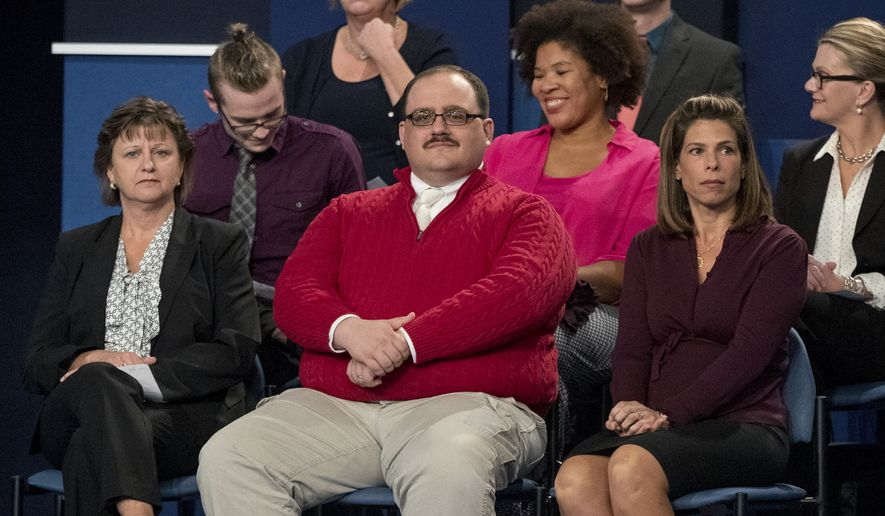 In this Oct. 9, 2016, file photo, Kenneth Bone sits in the audience before the start of the second presidential debate at Washington University in St. Louis. (AP Photo/Andrew Harnik, File)