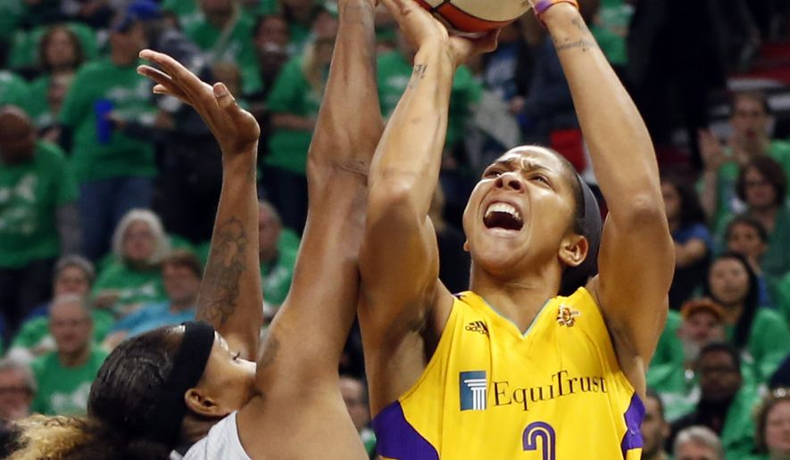 Los Angeles Sparks' Candace Parker, right, attempts to shoot over Minnesota Lynx's Rebekkah Brunson in the first quarter during Game 5 of the WNBA basketball finals Thursday, Oct. 20, 2016, in Minneapolis. (AP Photo/Jim Mone)