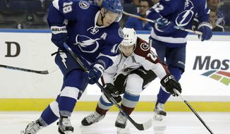 Tampa Bay Lightning left wing Ondrej Palat (18), of the Czech Republic, steals the puck away from Colorado Avalanche center Nathan MacKinnon (29) during the second period of an NHL hockey game Thursday, Oct. 20, 2016, in Tampa, Fla. (AP Photo/Chris O'Meara)
