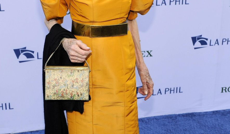 FILE - In this Sept. 27, 2011 file photo, Betsy Bloomingdale arrives at the Los Angeles Philharmonic Opening Night Gala in Los Angeles. Personal belongings of the late fashion icon, socialite and philanthropist Betsy Bloomingdale will be auctioned by Christie's in New York later this year and in the Spring of 2017. (AP Photo/Chris Pizzello, File)
