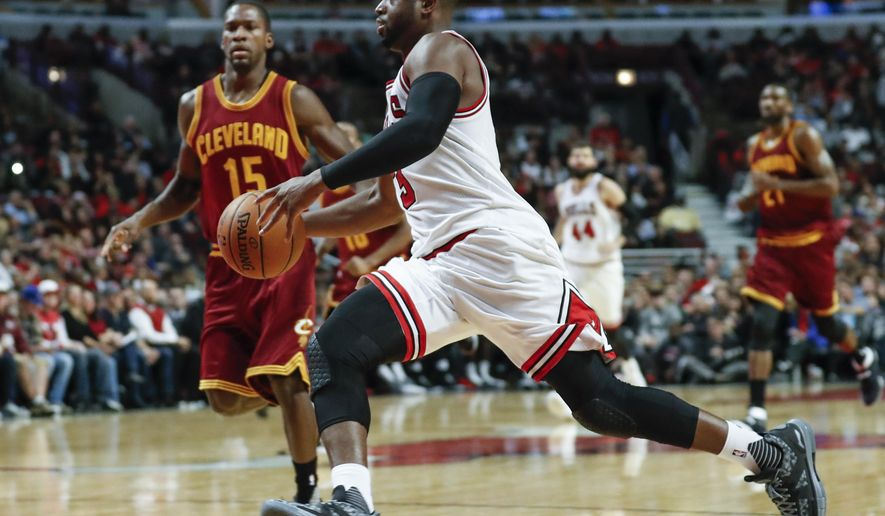 FILE - In this Oct. 14, 2016, file photo Chicago Bulls' Dwyane Wade drives against the Cleveland Cavaliers during an NBA preseason basketball game in Chicago. The Bulls figure to be a whole lot more interesting this season with the additions of Wade and Rajon Rondo. (AP Photo/Kamil Krzaczynski File)