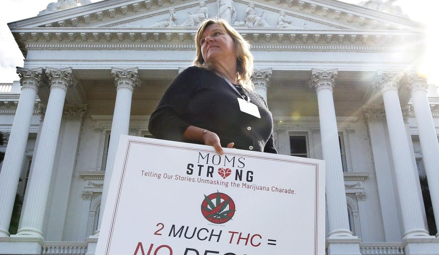 FILE - In this Oct. 4, 2016 file photo, Carolyn Channing joins others at a rally against Proposition 64 at the Capitol in Sacramento, Calif. If approved by California voters in November, Proposition 64 would legalize the recreational use of marijuana. Campaign reports show political donors have spent a record $450 million for and against 17 measures on California's November ballot, breaking the previous campaign spending record of $438 million set in 2008.  (AP Photo/Rich Pedroncelli,file)
