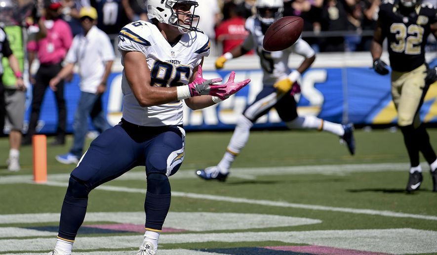 ADVANCE FOR WEEKEND EDITIONS, OCT. 22-23 - FILE - In this Sunday, Oct. 2, 2016, file photo, San Diego Chargers tight end Hunter Henry, left, hauls in a touchdown pass during the first half of an NFL football game against the New Orleans Saints in San Diego. Even though Antonio Gates has two years left on his contract, the Chargers are getting a glimpse of his replacement, and they like what they see. Sure-handed rookie Hunter Henry has so far made a seamless transition from college, with a touchdown catch in each of his last three games.  (AP Photo/Denis Poroy, File)
