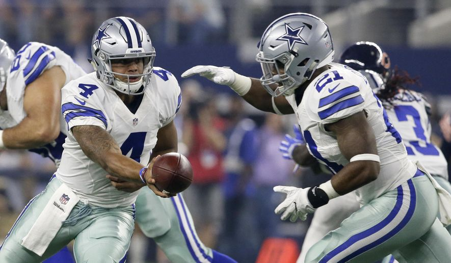 ADVANCE FOR WEEKEND EDITIONS, OCT. 22-23 - FILE - In this Sept. 25, 2016, file photo, Dallas Cowboys quarterback Dak Prescott (4) hands the ball off to running back Ezekiel Elliott, right, in the first half of an NFL football game against the Chicago Bears in Arlington, Texas. Six weeks ago, they were a Dallas novelty. the first rookie quarterback-running back combo to start the season for the Cowboys since Roger Staubach and Calvin Hill nearly 50 years ago. Now they are the future of the Dallas offense. (AP Photo/LM Otero, File)