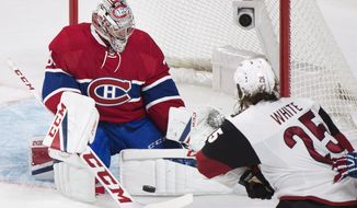 Montreal Canadiens goaltender Carey Price makes a save against Arizona Coyotes' Ryan White during the first period of an NHL hockey game, Thursday, Oct. 20, 2016 in Montreal. (Graham Hughes/The Canadian Press via AP)