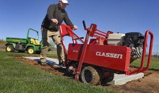 ADVANCED FOR RELEASE MONDAY, OCTOBER 24, 2016 Brian Deyak, ProFields LLC, works on a movable pitchers mound Thursday, Oct. 13, 2016, at Pine Cone Central Park in Sartell, Minn. Deyak's new turf management company has been working on a number of projects in the area. (Jason Wachter/St. Cloud Times via AP)