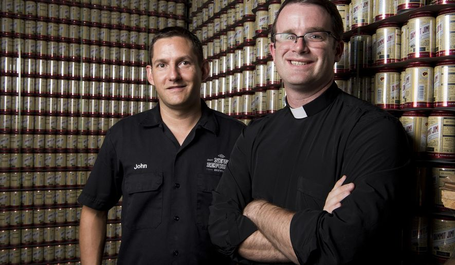 In this Wednesday, Oct. 5, 2016 photo, Father Ryan Higdon, right, and co-owner of New Republic Brewing John Januskey pose during a portrait session, at New Republic Brewing in College Station, Texas. (Timothy Hurst /College Station Eagle via AP)