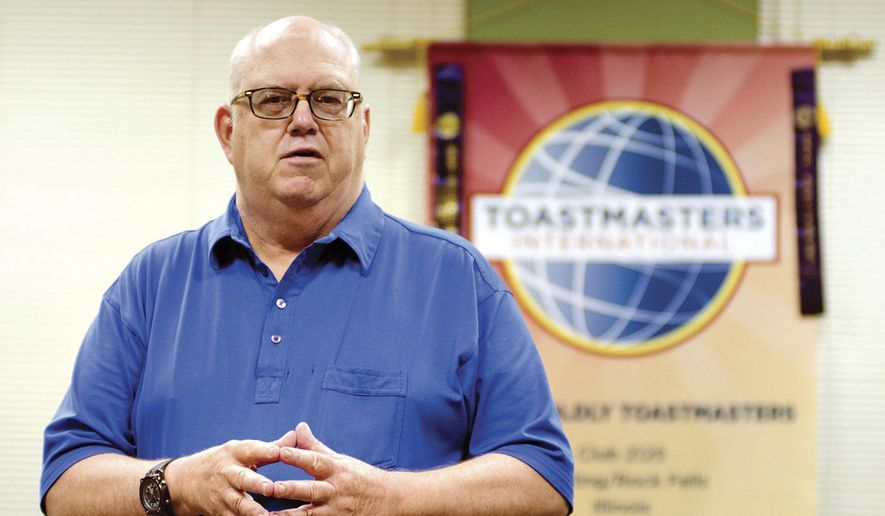 "ADVANCE FOR USE SUNDAY, OCT. 23, 2016 AND THEREAFTER - In this Sept. 22, 2016 photo, Jim Dickson starts a meeting of the Toastmasters in Sterling,  Ill., with a speech about a camping trip taken out west many years ago. The men and women of Toastmasters work to become more competent communicators, improve their listening skills, and learn the importance of speech ""icebreakers"" and visual aids. Extra credit is given by using the word during presentations. (Alex T. Paschal/Sauk Valley Media via AP)"