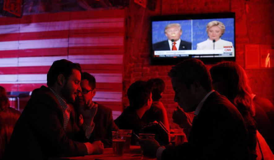 Customers watch the third and last U.S. presidential debate at the Pinche Gringo BBQ restaurant in Mexico City, Wednesday, Oct. 19, 2016. The debate is being held in Las Vegas. (AP Photo/Dario Lopez-Mills)