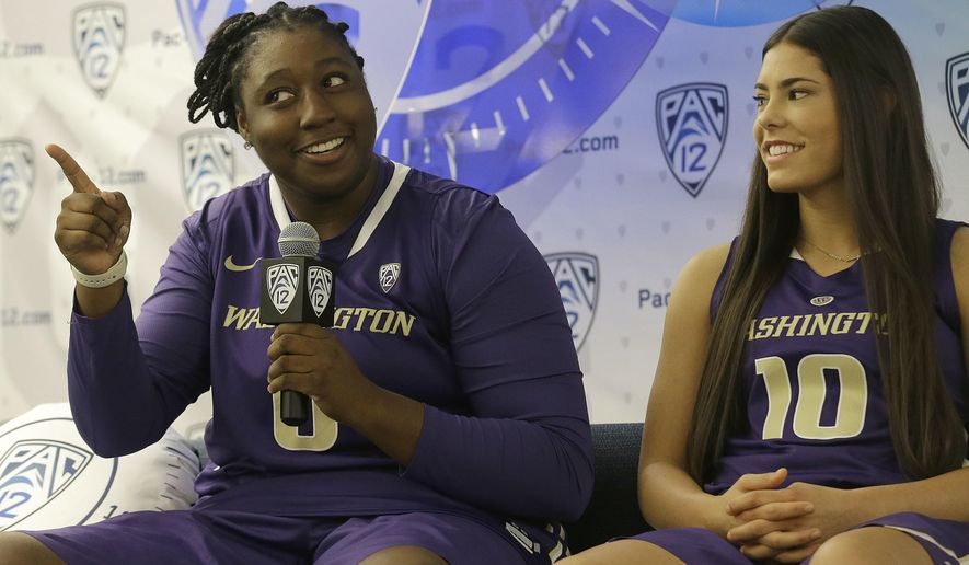 Washington's Chantel Osahor, left, speaks next to Kelsey Plum at the NCAA college basketball Pac-12 media day in San Francisco, Thursday, Oct. 20, 2016. (AP Photo/Jeff Chiu)