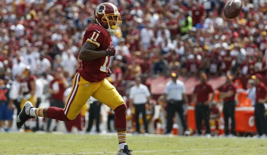 In this photo taken Sept. 18, 2016, Washington Redskins wide receiver DeSean Jackson (11) chases an overthrown ball during the first half of an NFL football game against the Dallas Cowboys in Landover, Md. Washington Redskins wide receiver Jackson and tight end Jordan Reed have missed practice, putting their availability for the Sunday, Oct. 23, 2016 game at the Detroit Lions into question.  (AP Photo/Alex Brandon)