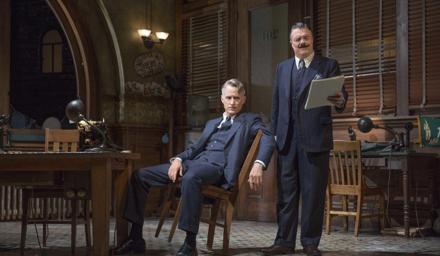 """In this undated photo provided by O&M/DKC, John Slattery, left, and Nathan Lane perform in a scene from the production of """"The Front Page."""" The play opened Thursday, Oct. 20, 2016, at the Broadhurst Theatre in New York under the direction of three-time Tony Award-winner Jack O'Brien.  (Julieta Cervantes/O&M/DKC via AP)"""