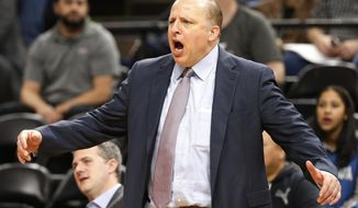 In this Oct. 19, 2016 file photo, Minnesota Timberwolves head coach Tom Thibodeau directs his team against the Memphis Grizzlies in Minneapolis. Thibodeau has the reputation as a basketball robot, the ultimate grinder who puts the game over everything else in his life. In his short time in Minnesota, it's already clear who's running the show. (AP Photo/Jim Mone,File)