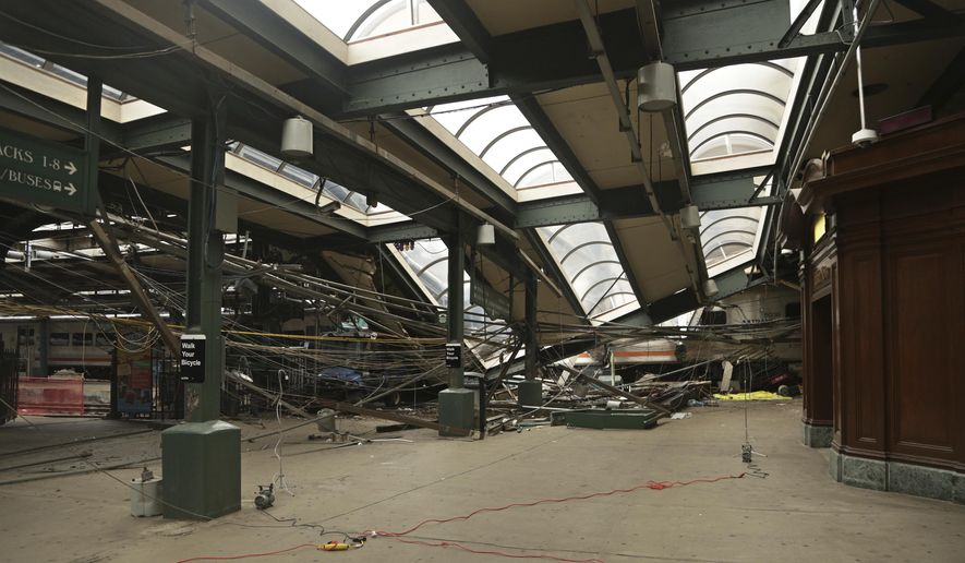 FILE - This Oct. 1, 2016, file photo provided by the National Transportation Safety Board shows damage done to the Hoboken Terminal in Hoboken, N.J., after a commuter train crash that killed one person and injured more than 100 others. New Jersey legislators will consider granting themselves subpoena power as they begin to look into last month's New Jersey Transit train crash. The Democrat-led Assembly Judiciary Committee is expected to consider subpoena authorization on Thursday, Oct. 20, 2016. (Chris O'Neil/NTSB photo via AP, File)