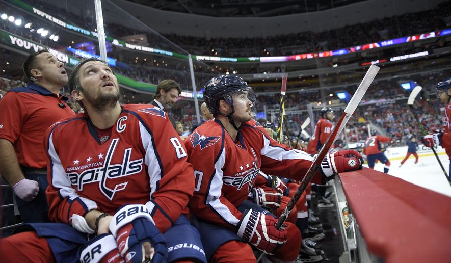 Washington Capitals left wing Alex Ovechkin (8), of Russia, and left wing Marcus Johansson, right, of Sweden, look on from the bench during the third period of an NHL hockey game against the Colorado Avalanche, Tuesday, Oct. 18, 2016, in Washington. The Capitals won 3-0. (AP Photo/Nick Wass)