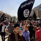 In this June 16, 2014, file photo, demonstrators chant pro-Islamic State group slogans as they carry the group's flags in front of the provincial government headquarters in Mosul, Iraq. (AP Photo, File)