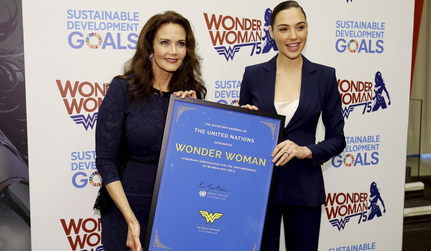 "In this image released by Starpix, actress Lynda Carter, who starred in the 1970s series,""Wonder Woman,"" left, and actress Gal Gadot, who stars in the upcoming film, ""Wonder Woman,"" appear at a United Nations event naming the super hero character as an Honorary Ambassador For the Empowerment of Women and girls, Friday, Oct. 21, 2016, at the United Nations.  (Marion Curtis/Starpix via AP)"