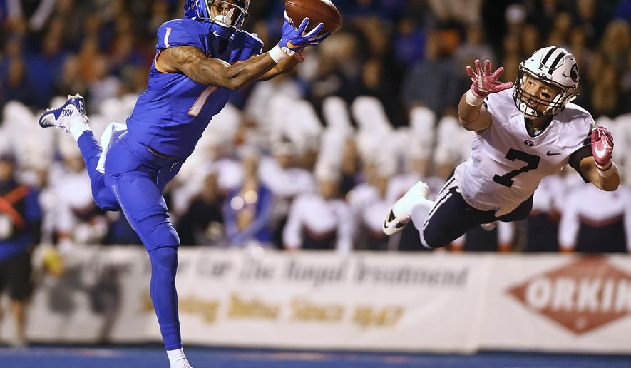 Boise State wide receiver Cedrick Wilson (1) catches a deep throw for a touchdown next to BYU defensive back Micah Hannemann (7) during an NCAA college football game Thursday, Oct. 20, 2016, in Boise, Idaho. (Pat Sutphin/The Times-News via AP)