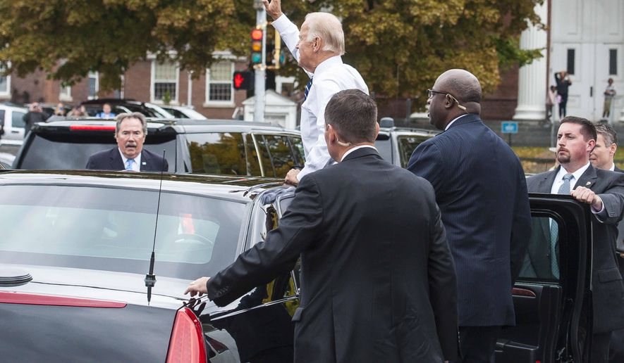 Vice President Joe Biden waves to the crowd outside of the Penny Cluse Cafe in Burlington, Vt., Friday, Oct. 21, 2016, before participating in a Cancer Moonshot Roundtable at the University of Vermont. With Biden are Sent. Patrick Leahy, left, D-Vt., and Democratic gubernatorial candidate Sue Minter. (Glenn Russell/The Burlington Free Press via AP, Pool)