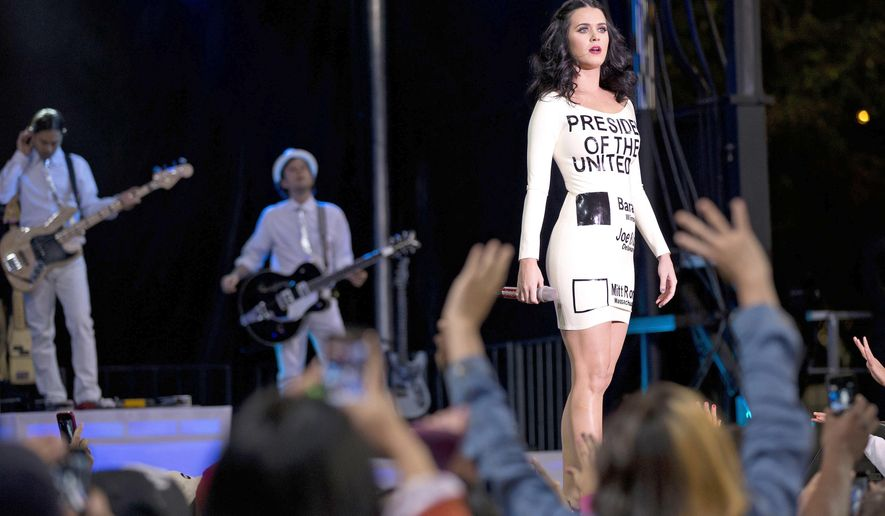 FILE - In this Oct. 24, 2012 file photo, singer Katy Perry, wearing a dress that resembles a ballot, performs for a crowd before the arrival of President Barack Obama at a campaign rally in Las Vegas. Perry is the latest star to campaign in Las Vegas on behalf of Hillary Clinton. She will be headlining a rally Saturday afternoon, Oct. 22, 2016, at UNLV with Democratic Senate candidate Catherine Cortez Masto, and then will take a first-time voter to the polls. (AP Photo/Julie Jacobson, File)