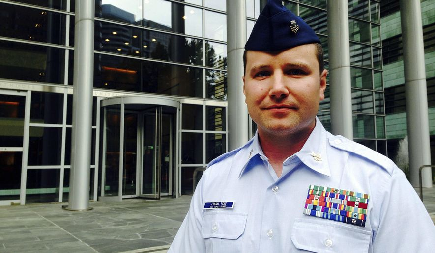 "U.S. Coast Guard Petty Officer Daniel Hamilton poses outside the U.S. Courthouse in Seattle Friday, Oct. 21, 2016. Hamilton said he found ""red flags"" when he inspected the cargo ship Gallia Graeca as it arrived in Seattle in October 2015, leading to an investigation that found the ship had dumped 5,000 gallons of oily bilge water in the high seas and falsified records in an effort to cover it up. A federal judge on Friday ordered the companies that own and operate the vessel to pay $1.5 million. (AP Photo/Gene Johnson)"