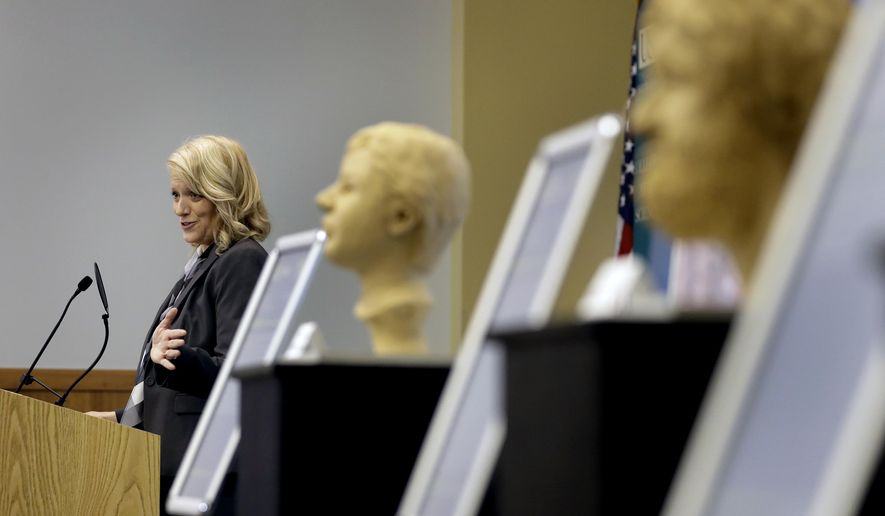 Dr. Erin Kimmerle, associate professor n the Department of Anthropology at the University of South Florida, gestures as she speaks to the members of the Art of Forensics conference Friday, Oct. 21, 2016, in Tampa, Fla. Kimmerle, and several forensic artists, have been working with law enforcement officials on cold cases in Florida to help give victims a face in hopes family members may recognize them. (AP Photo/Chris O'Meara)