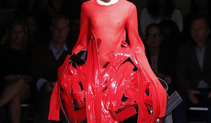 FILE - In this Sept. 27, 2014 file photo, a model wears a creation by Japanese fashion designer Rei Kawakubo for Comme Des Garcons' Spring/Summer 2015 ready-to-wear fashion collection presented at Fashion Week in Paris. The annual Met Gala, one of the most anticipated events in the fashion world, will honor Kawakubo. The May 1 gala will be chaired by music stars Katy Perry and Pharrell Williams, as well as Vogue editor Anna Wintour.   (AP Photo/Francois Mori, File)