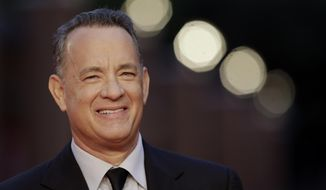 In this Thursday, Oct. 13, 2016, file photo, actor Tom Hanks arrives to receive a lifetime achievement at the Rome Film Festival, in Rome. (AP Photo/Andrew Medichini, file)