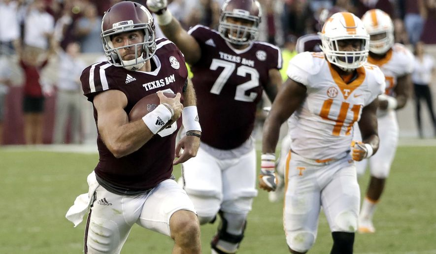 FILE - In this Saturday, Oct. 8, 2016, file photo, Texas A&M quarterback Trevor Knight (8) rushes for a touchdown against Tennessee during the second half of an NCAA college football game in College Station, Texas. Knight could get the beat-Bama bump  in the Heisman trace with a big game in Tuscaloosa.  (AP Photo/David J. Phillip, File)