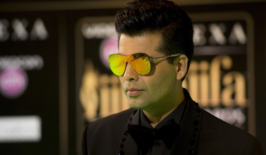 """FILE - In this June 24, 2016, file photo, Bollywood film maker Karan Johar poses for photographers at the International Indian Film Academy (IIFA) Rocks Green Carpet for the 17th Edition of IIFA Weekend and Awards in Madrid, Spain. Political tensions erupted in September 2016 between nuclear-armed neighbors after the deadly rebel attack on an Indian military base which has resulted in Hindu nationalists asking for a boycott of all Pakistani artists. Johar released a video message asking Hindu nationalist protesters to not disrupt the Oct. 28 release of his big-budget romantic drama """"Ae Dil Hai Mushkil,"""" or """"Difficulties of the Heart,"""" which features Pakistani actor Fawad Khan in a small role after (AP Photo/Samuel de Roman, File)"""
