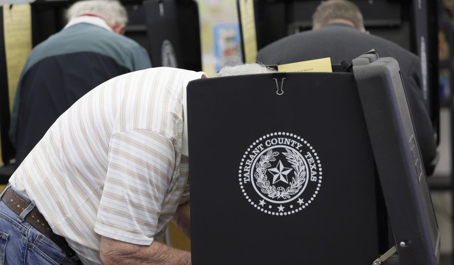 "In this March 1, 2016 file photo, voters make their choice in the ballot booth during primary election day at Sherrod Elementary School in Arlington, Texas. Officials in Texas, Oklahoma and Louisiana say they've denied a request by Russian officials to be present at polling stations during the November general election. The U.S. State Department's spokesman says Russia hasn't participated in an international mission to observe elections, so its effort to do so on the state level represents ""nothing more than a PR stunt."" (AP Photo/LM Otero, File)"