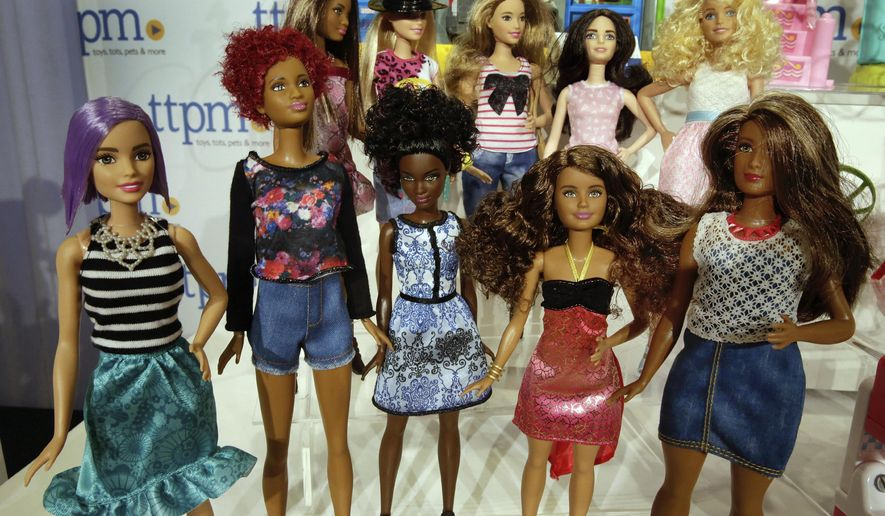 This Thursday, Oct. 6, 2016, photo shows Barbie Fashionistas, from Mattel, on display at the annual TTPM Holiday Showcase, in New York. Toy companies are offering products that are more inclusive, from Barbie dolls in all shapes, sizes and skin tones to baby dolls aimed at boys. Toy companies are also offering dolls that represent different disabilities. But still experts and parents say more work needs to be done. (AP Photo/Richard Drew)
